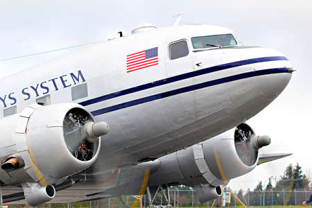 MUKILTEO - MARCH 02  DC-3 N877MG inaugural flight on March 20, 2013 in Mukilteo, Washington  The DC-3 re-enters service after an extensive restoration undertaken by the Historic Flight Foundation