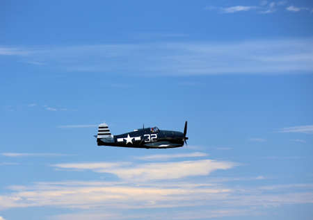 wa: EVERETT -  JUNE 29  A restored World War 2 Grumman F6F-5 Hellcat was seeing flying in the skies over Everett Paine Field on 29 June 2013 near Seattle, WA