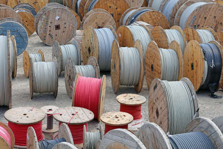 power cables: Cable storage yard with drums of cables