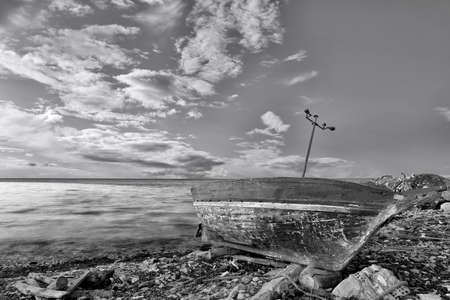 Seascape with old derelict fishing boat photo