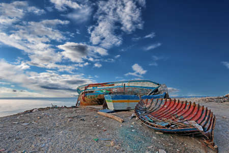 ship wreck: Seascape with old derelict fishing boat
