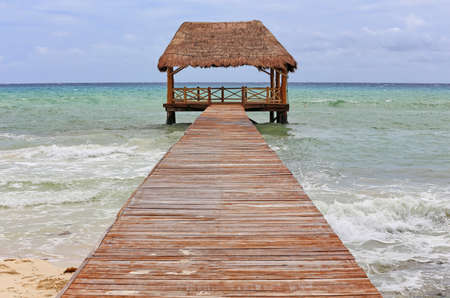 Wooden pier with hut built over the sea