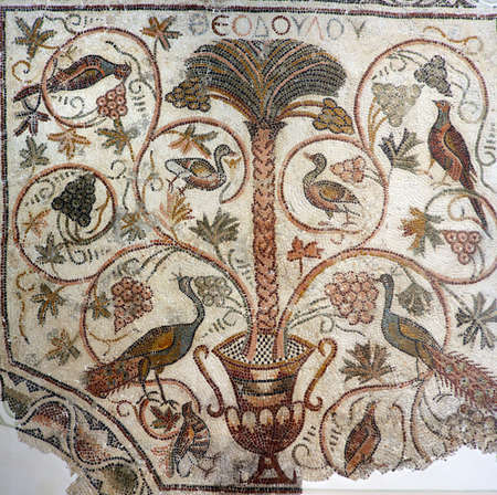 mosaic: Beautiful ancient mosaic from the early Byzantine period depicting a palm tree and birds