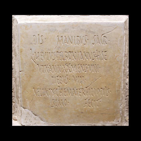 lived here: 1st Century AD Roman fumeral stone  To the god of death named Lucius Mevius Petonianus; who lived 20 years, 8 months and 8 days  He is buried here  This epitaph is done by Aelia Tyche to her worthy son