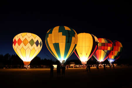 The glow of a hot air balloon at night