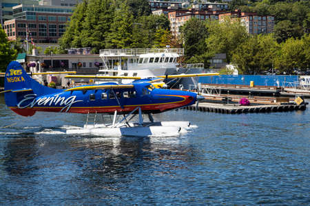 Seattle, Washington - JULY 6, 2014: Kenmore Air seaplane on Lake Union. Kenmore Air, a family-run Seattle seaplane airline with a warm and effortless approach to hospitality