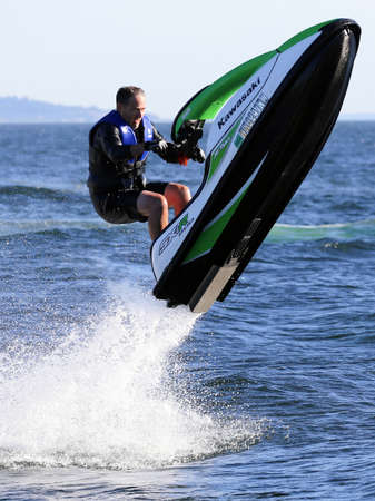 water skiing: Seattle, Washington - JULY 9, 2014: Jet Ski from Kawasaki, a manufacturer of premier personal watercraft