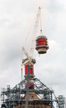 heavy industry: Crane doing a heavy lift of a stack section.