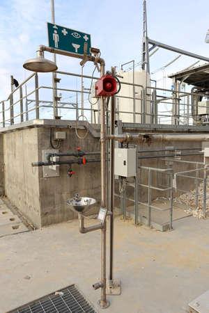 Industrial safety shower and eye wash station Standard-Bild