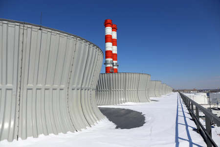 Industrial cooling tower on a combined cycle power plant Stock Photo