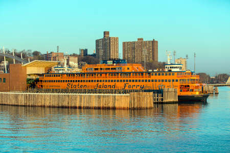 staten: STATEN ISLAND, USA, APRIL 19, 2015: Dawn sunlight reflecting off the Staten Island Ferry, a free ferry service between St. George on Staten Island and Whitehall Street in lower Manhattan Editorial