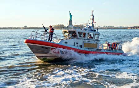 speed gun: NEW YORK CITY, USA - APRIL 19: U.S. Coast Guard boat patrolling the Hudson River bay. April 19, 2015 in New York City, USA