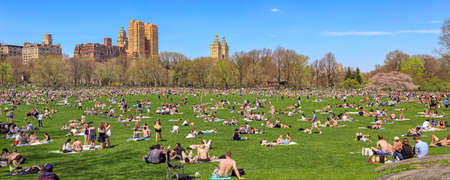 warmest: New York, NY, USA - April 19, 2015: Sheep Meadow: New Yorkers enjoying a hot spring day in Sheep Meadow, Central Park with Upper West Side in the background. Saturday was the warmest day in 6 months. Editorial