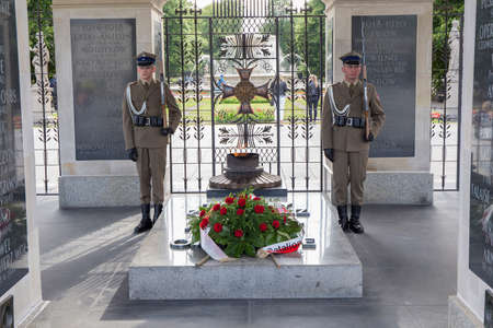 tomb of the unknown soldier: WARSAW, POLAND - JUNE, 20: The Tomb of the Unknown Soldier at Pilsudski Square, on June 20, 2015. Tomb of the Unknown with eternal flame, since 1925. Part of the Saxon Palace at Pilsudski Square, Warsaw, Poland