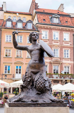 mermaid: Warsaw, Poland, June 20, 2015: View of Warsaw old town and the Warsaw Mermaid Editorial