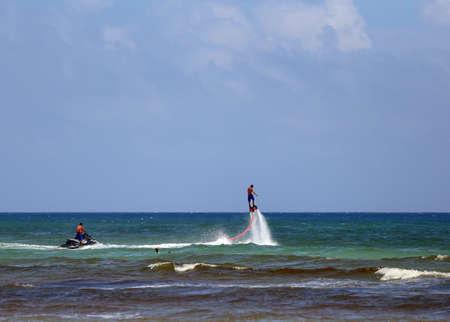 jetski: Flyboarding using a jetski Stock Photo