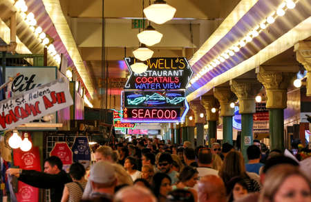 SEATTLE SEPTEMBER 21: Customers and tourists at Pike Place Market on September 21, 2014. This market, opened in 1930 is one of Seattles most popular tourist attractions.