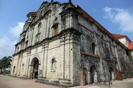 The Church of Santa Monica, the first church built on Panay, Philippines, was constructed in 1774 under the Spanish. It is a national historic site and home of the biggest bronze church bell in Asia. Stock Photo