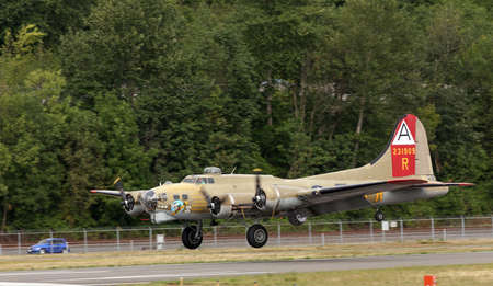 recognized: SEATTLE - JULY 03, 2016: The B-17G FLying Fortress - One of the most recognized WWII aricraft.