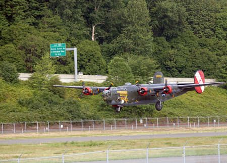 the liberator: SEATTLE - JULY 03, 2016: A vintage WWII B-24J Liberator bomber was seen flying over Seattle Editorial