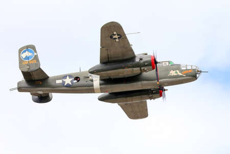 wwii: SEATTLE - JULY 03, 2016: A vintage WWII B-25J Mitchell bomber was seen flying over the skies of Seattle. Editorial