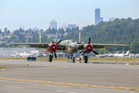 bomber: SEATTLE - JULY 03, 2016: A vintage WWII B-25J Mitchell bomber was seen flying over the skies of Seattle. Editorial