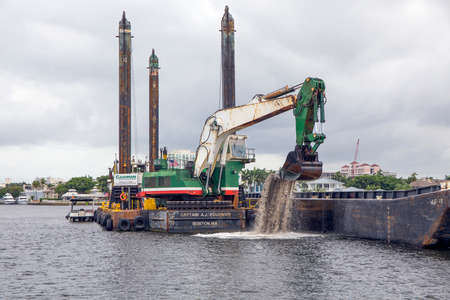 Ft Lauderdale, FL, USA - June 22, 2016: The Captain A.J Fournier is a Liebherr 994 Excavator Dredge used for channel, pier and dock excavations and trenching.