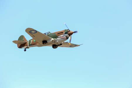 Everett, WA, USA - July 30, 2016: A P-40 Warhawk was seen flying over Everett Paine Field