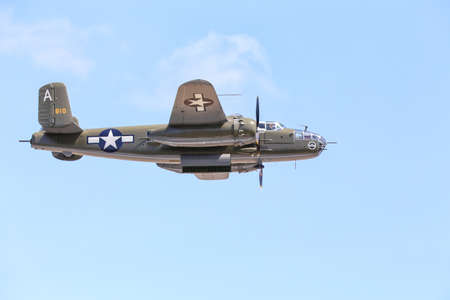 bomber: Everett, WA, USA - July 30, 2016: A North American B-25J Mitchell bomber was seen flying over Everett Paine Field.