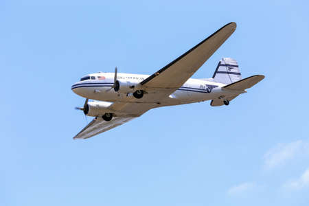 Everett, WA, USA - July 30, 2016: A vintage DC-3 was seen flying over Everett Paine Field