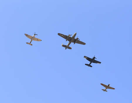 warbirds: Everett, WA, USA - July 30, 2016: A collection of World War II aircaraft was seen flying over Everett Paine Field