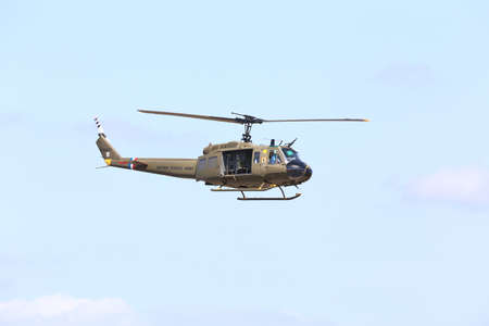 Everett, WA, USA - July 30, 2016: A Bell UH-1 Iroquois Huey helicopter was seen flying over Everett Paine Field
