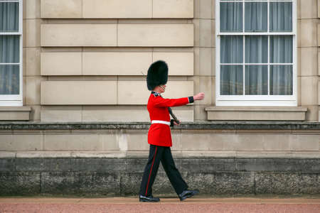 London, England, UK - October 12, 2013: The Queen's Guard on duty at Buckinbham Palace, the official residence of the Queen of England Stock Photo - 67363173
