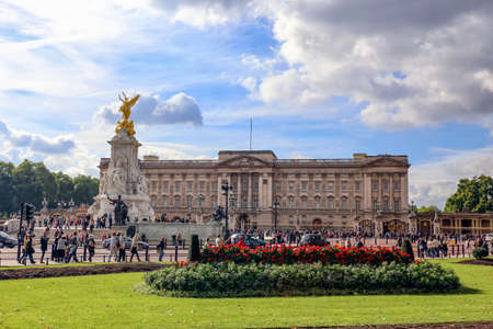 London, England, UK - October 12, 2013: A view of Buckingham Palace with Queen Victoria Statue