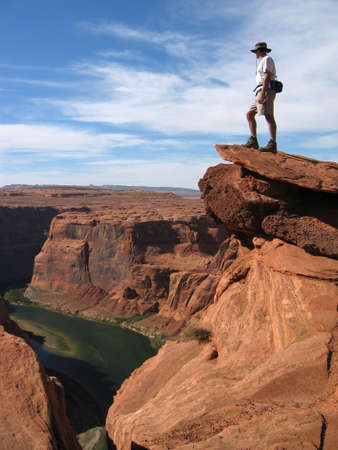 Hiker Overlooking Colorado river in Grand Canyon Stock Photo - 635552