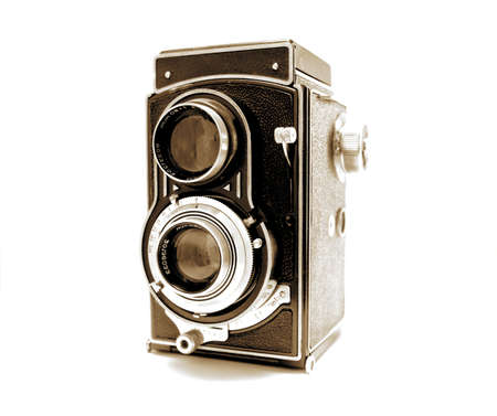 Old Photo Camera isolated on white background, in sepia tones