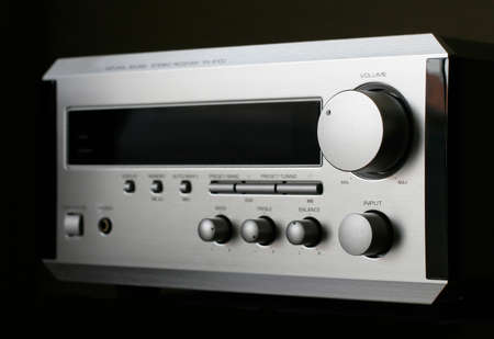 Silver Audio Receiver on black background Stock Photo