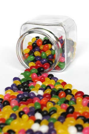 Candies Spilling out of Glass Jar photo