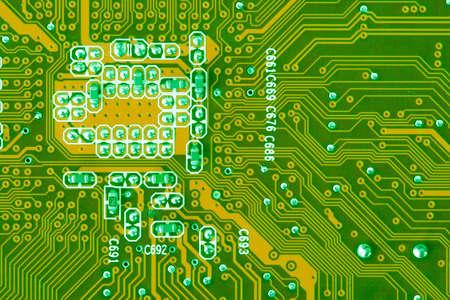 Green Computer Circuit Board closeup photo