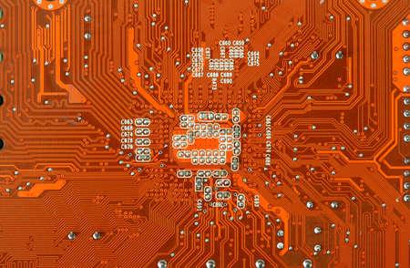 Orange Computer Circuit Board closeup photo