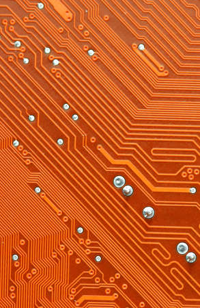 Orange Computer Circuit Board closeup photo
