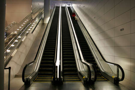 Woman on escalators in newly opened Airport