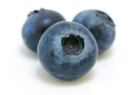trio: Organic Blueberries trio isolated on white background Stock Photo