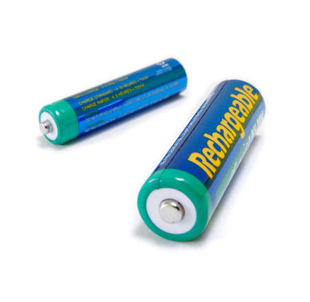 tense: Rechargeable NiMH AA and AAA Batteries isolated on white background