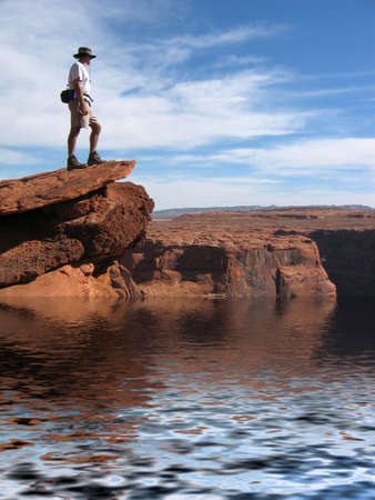 Hiker Overlooking Colorado river in Grand Canyon photo