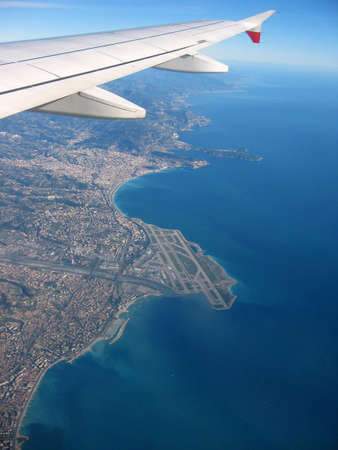 overhead: An aerial view of Nice Airport and French riviera from an airplane, flying back to US. Stock Photo
