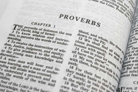 scripture: Bible close-up on Proverbs with shallow DOF