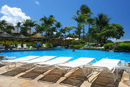 Swimming pool in a tropical resort Stock Photo