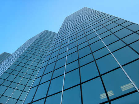 Looking up Modern building on pure blue sky