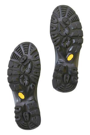 Bottom of hiking shoes isolated on pure white background photo